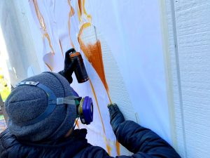 Up close spray painting Fnnch Fisherman's Wharf Honey Bear Mural